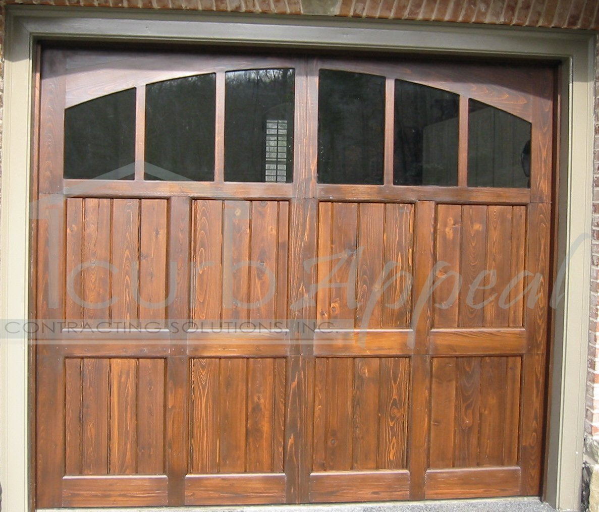 Custom carriage garage doors for atlanta ga for Wood doors with windows
